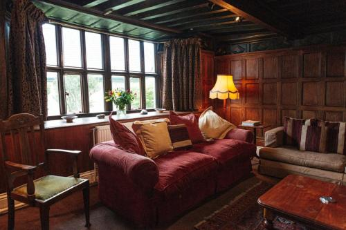 Oak Paneling and Mullioned Windows in Drawing Room